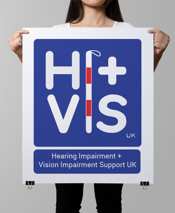 Photo of person holding a large placard with Hi-VisUK logo on.